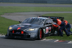 Marshalls attempt in vain to push #59 Team Modena Aston Martin DBR9: Antonio Garcia, Christian Fittipaldi off the curb