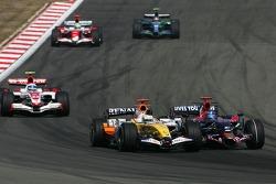 Giancarlo Fisichella, Renault F1 Team, R27 and Vitantonio Liuzzi, Scuderia Toro Rosso, STR02