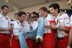 Race winner Felipe Massa celebrates with Scuderia Ferrari team members