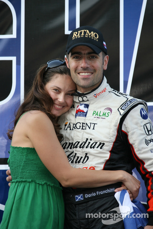 Victory lane: Dario Franchitti celebrates the win and the 2007 IndyCar Series championship with wife Ashley Judd