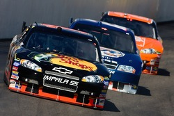 Martin Truex Jr. leads Kurt Busch and Tony Stewart