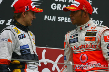 Podium: race winner Lewis Hamilton with Heikki Kovalainen