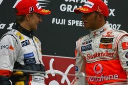 Podium: race winner Lewis Hamilton with Heikki Kovalainen