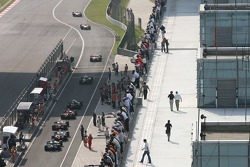 Cars leave the pits