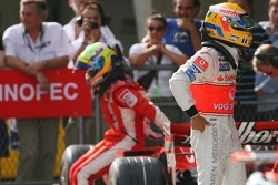 1st, Lewis Hamilton, McLaren Mercedes, MP4-22 and 3rd, Felipe Massa, Scuderia Ferrari, F2007