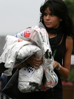 Raquel Rosario Wife of Fernando Alonso, carrying his overalls