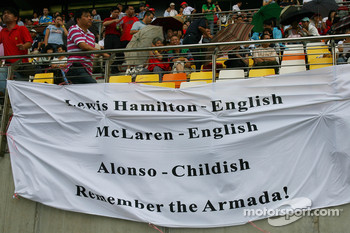 Lewis Hamilton, McLaren Mercedes fans with flag