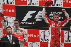 2nd place Fernando Alonso, McLaren Mercedes and 1st place Kimi Raikkonen, Scuderia Ferrari
