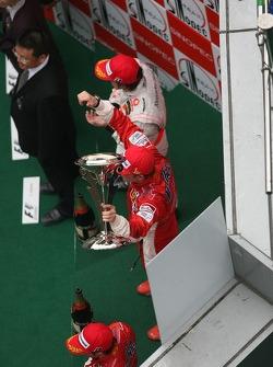 2nd place Fernando Alonso, McLaren Mercedes with 1st place Kimi Raikkonen, Scuderia Ferrari