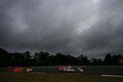 #37 Intersport Racing Lola B06/10 AER: Clint Field, Jon Field, Richard Berry, #7 Penske Racing Porsche RS Spyder: Romain Dumas, Timo Bernhard, Patrick Long