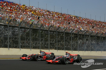 Start: Fernando Alonso, McLaren Mercedes, MP4-22 and Lewis Hamilton, McLaren Mercedes, MP4-22