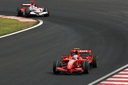 Kimi Raikkonen, Scuderia Ferrari, Takuma Sato, Super Aguri F1