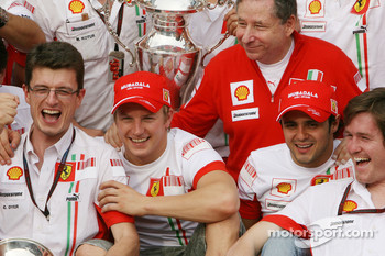 Chris Dyer, at Raikkonen right side, celebrates 2007 World Championship with Felipe Massa, Jean Todt, and Ferrari team members.