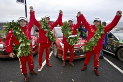 Podium: winners Sébastien Loeb and Daniel Elena celebrate with second place Daniel Sordo and Marc Marti