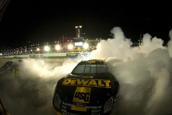Race winner Matt Kenseth and 2007 NASCAR Nextel Cup champion Jimmie Johnson celebrate with burnouts