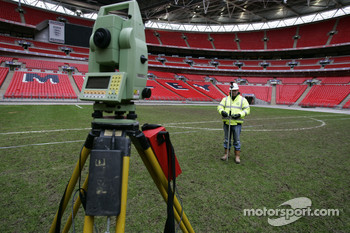 Saturday, November 24: the first and most crucial step in creating The Race of Champions track is pin-point measurements