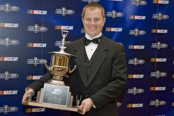 Third place driver, Jason Leffler, poses with his trophy