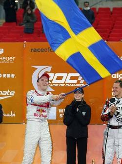 Podium: Race of Champions winner Mattias Ekström celebrates with second place Michael Schumacher