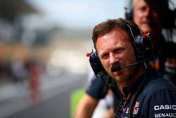 Red Bull Racing Team Principal Christian Horner looks on from the pit wall