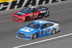 Cole Whitt, Front Row Motorsports Ford and Ryan Blaney, Woods Brothers Racing Ford