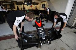 McLaren mechanics with a nose cone