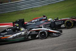 Fernando Alonso, McLaren MP4-30 and Sergio Perez, Sahara Force India F1 VJM08 battle for position