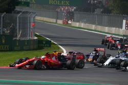 Sebastian Vettel, Ferrari SF15-T and Daniel Ricciardo, Red Bull Racing RB11 make contact at the start of the race