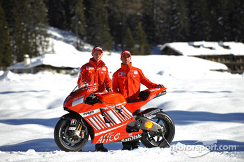 Marco Melandri and Casey Stoner pose with the Ducati Desmosedici GP8