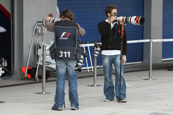 Photographers in the pitlane