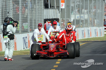 Kimi Raikkonen, Scuderia Ferrari stopped at entrance of Pit lane