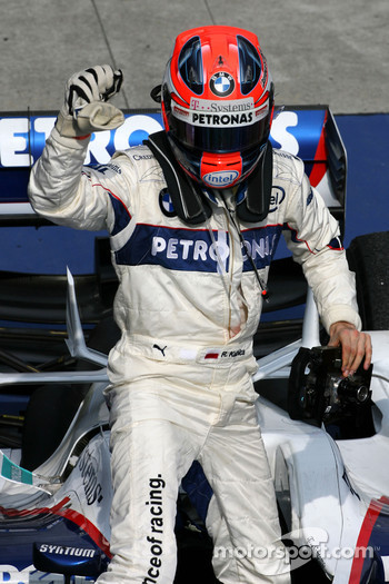 Second place Robert Kubica celebrates