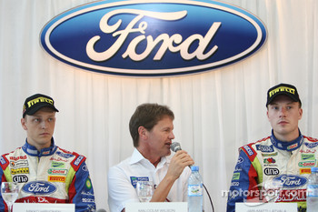 Malcolm Wilson answers questions at the Ford Dealer function near Cordoba with drivers Mikko Hirvonen and Jari-Matti Latvala
