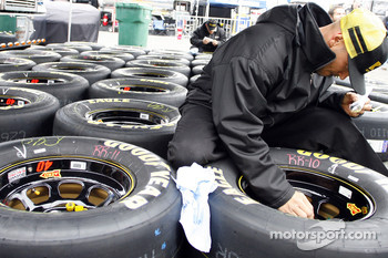 Crew members on the #40 Kennametal Dodge prepare tires