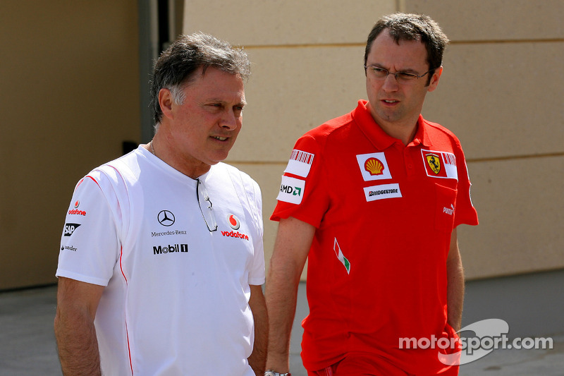 Dave Ryan, McLaren Mercedes, Team Manager with Stefano Domenicali, Scuderia Ferrari, Director