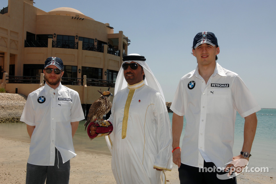 Nick Heidfeld and Robert Kubica with a falcon