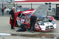 Work on Kasey Kahne's damaged car