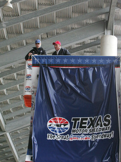Jimmie Johnson prepares to uncover his Championship Banner