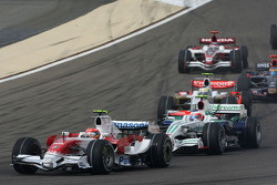 Timo Glock, Toyota F1 Team, TF108 and Rubens Barrichello, Honda Racing F1 Team, RA108