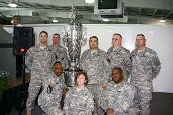 Members of the U.S. Army National Guard pose with the Borg-Warner Trophy