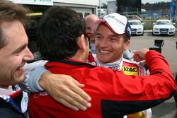 Hans-Jurgen Abt, Teamchef Abt-Audi, congratulates Timo Scheider, Audi Sport Team Abt Sportsline, with his pole position