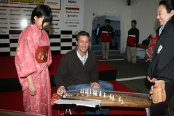 Honda Welcome Party: Tony George learns how to play a traditional Japanese intrument