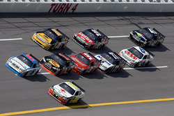 Elliott Sadler and Greg Biffle lead the pack into turn 4