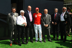 Bernie Ecclestone, President and CEO of Formula One Management with Juan Carlos I, King of Spain, Michael Schumacher, Test Driver, Scuderia Ferrari and Wili Weber