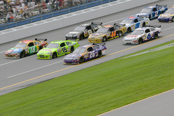 Jamie McMurray, Paul Menard and Kyle Busch all go three wide