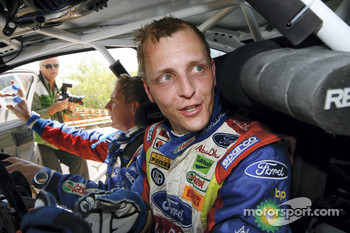 A delighted Mikko Hirvonen wins the 2008 Rally Jordan