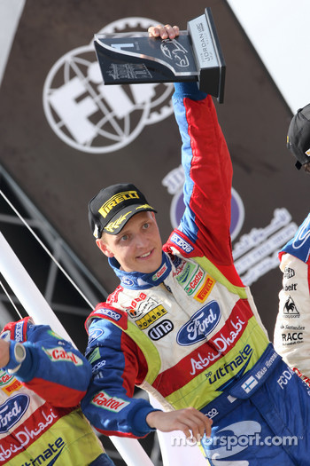 Podium: rally winner Mikko Hirvonen celebrates