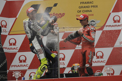 Podium: race winner Valentino Rossi celebrates with Dani Pedrosa and Casey Stoner