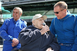 Al Unser waits for his interview with Tom Carnegie while son, Al Jr., finishes his
