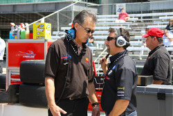 Michael Andretti, right, talks with a member of the Newman Haas Lanigan team
