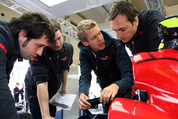 Sebastian Vettel, Scuderia Toro Rosso talks with engineers and mechanics